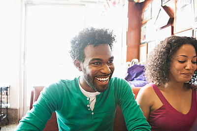 Smiling African American couple in diner - p1427m2271505 by Sam Bloomberg-Rissman