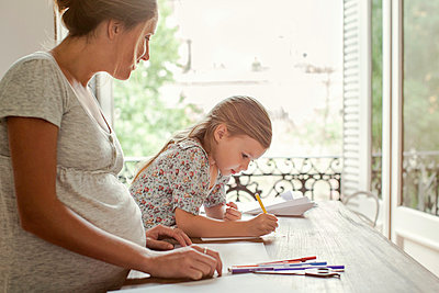 Mother and daughter coloring together - p623m1125423f by Sigrid Olsson