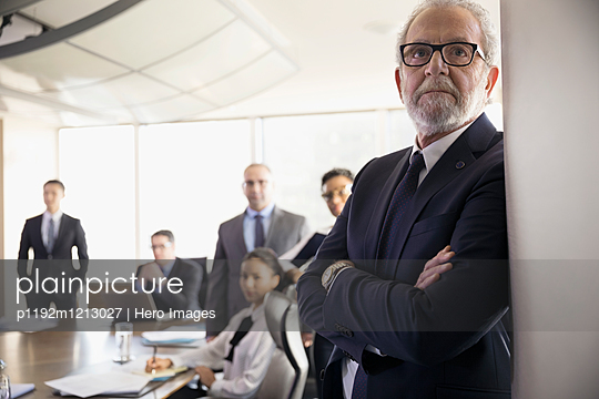 Serious attentive male lawyer listening in conference room meeting