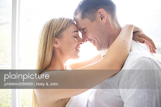Couple in love embracing lovingly - p1640m2259559 by Holly & John