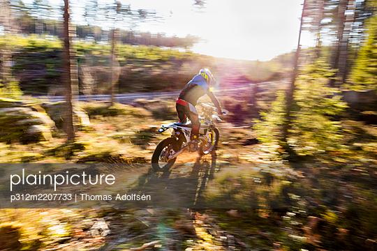 Motocross biker at forest - p312m2207733 by Thomas Adolfsén