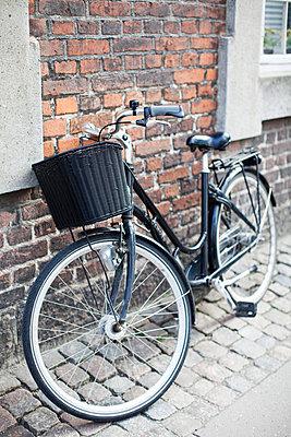 Bicycle on roadside - p4268487f by Sonja Dahlgren