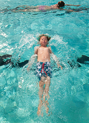 A boy swimming in a swimming pool   - p8476854 by Ulf Lundin