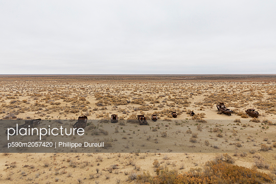 Boat cemetery in Moynaq, village on the Aral Sea - p590m2057420 by Philippe Dureuil