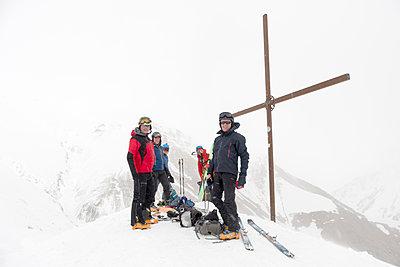Georgia, Caucasus, Gudauri, peeope at summit cross on a ski tour - p300m2102455 by Alun Richardson