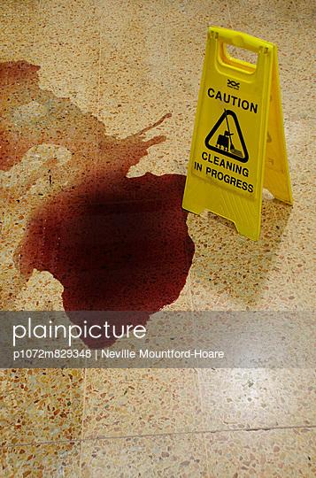 Red wine spilt on supermarket floor - p1072m829348 by Neville Mountford-Hoare