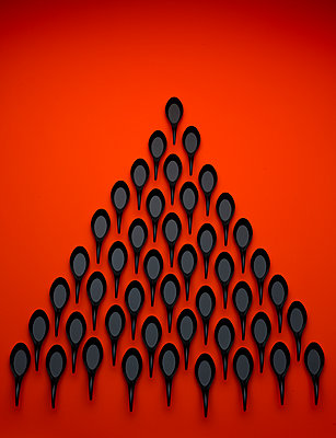 Plastic spoons against red background - p1318m2031945 by Tom Seelbach
