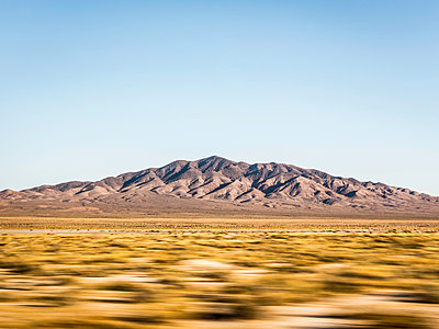 Blurred motion landscape in Death Valley National Park, California, USA - p429m1469263 by Manuel Sulzer