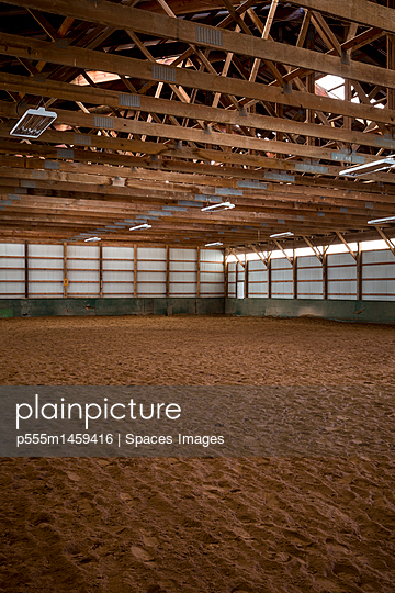 Empty indoor horse riding ring