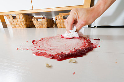 Hand wiping jam from floor - p300m1052995f by visual2020vision