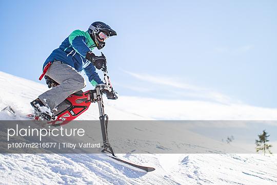 France, Man riding skibike - p1007m2216577 by Tilby Vattard