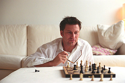Man playing Chess - p4737183f by Stock4B