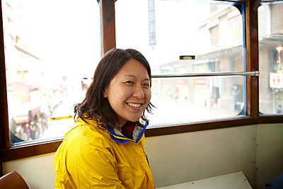 Portrait of woman in tram - p924m699210f by Ryan Benyi Photography