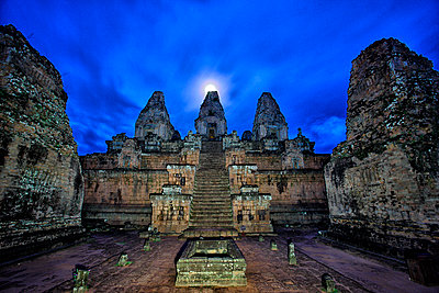 View of Pre Rup temple and rain falling on back - p343m1101538f by David Santiago Garcia