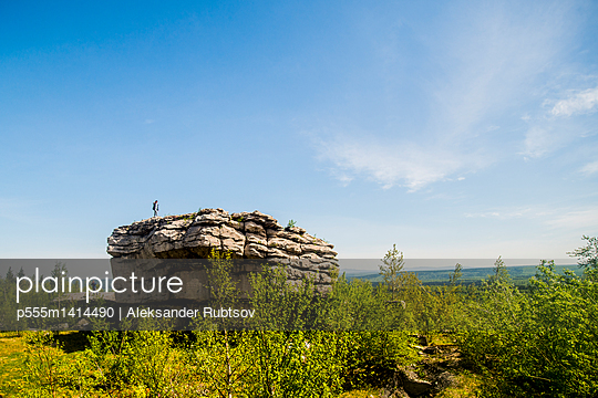 Caucasian climber standing on rock formation - p555m1414490 by Aleksander Rubtsov