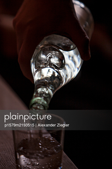 Mineral water being poured into glass - p1579m2193515 by Alexander Ziegler