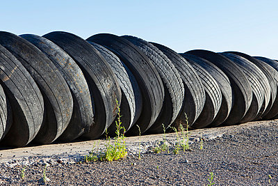 A row of discarded automobile tires stacked up near Wendover, in Utah.  - p1100m876039f by Paul Edmondson