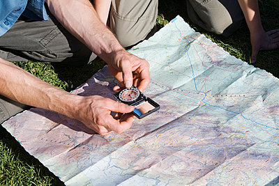 Man holding compass - p6090027f by CAMP photography
