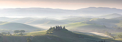 Misty dawn panoramic view towards Belvedere, across Val d'Orcia, UNESCO World Heritage Site, San Quirico d'Orcia, near Pienza, Tuscany, Italy, Europe - p871m1073962f by Lee Frost
