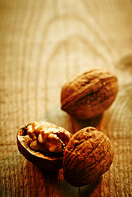 Walnuts on a wooden table - p968m658855 by roberto pastrovicchio