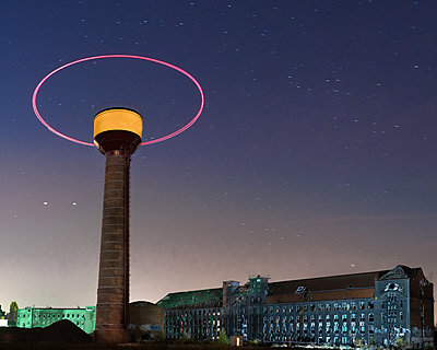 Long-term exposure,  Drone flying around a tower - p1549m2158051 by Sam Green