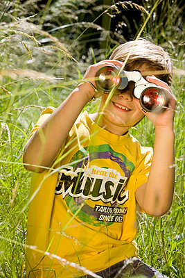 Boy looking through binoculars - p7610025 by Adeleida