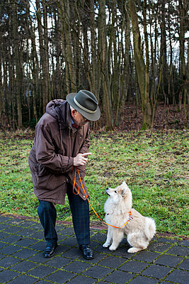 Man with dog - p1291m1548061 by Marcus Bastel