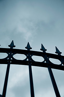 Metal fence against a dark  sky - p794m1477253 by Mohamad Itani