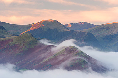 Catbells mountain surrounded by morning mist in autumn, Lake District National Park, Cumbria, England, United Kingdom, Europe - p871m1048043 by Adam Burton
