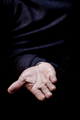 Hand of a man offering - p4450986 by Marie Docher