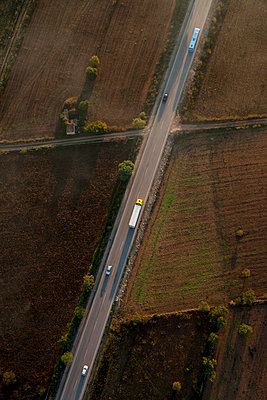Aerial view of cars on highway - p312m746788 by Peter Hoelstad