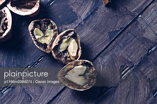 still life of broken heart shape walnuts prepared to eat - p1166m2084274 by Cavan Images
