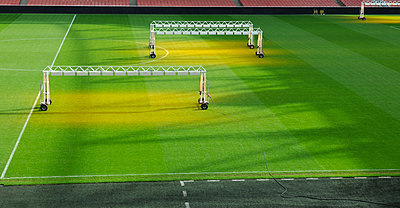 Ultra violet football pitch - p1048m1123507 by Mark Wagner