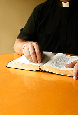 A priest reading the Bible - p4426015f by Design Pics