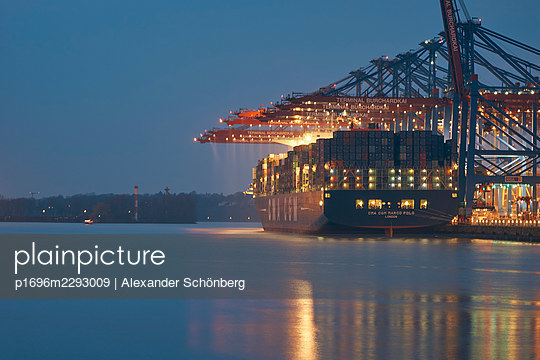 Container ship in the harbour - p1696m2293009 by Alexander Schönberg