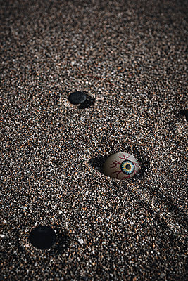 Artificial eye in the sand - p1681m2283411 by Juan Alfonso Solis