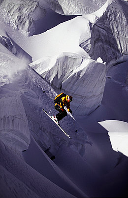 Extreme skier jumping of a serac into shadowland - p3433631 by Patrik Lindqvist