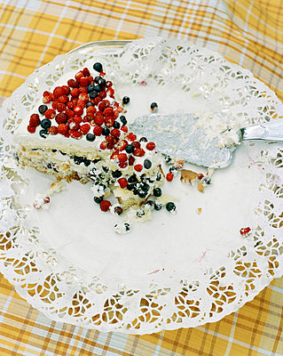 A cake garnished with wild strawberries and bilberries Sweden.  - p31216794f by Fredrik Nyman