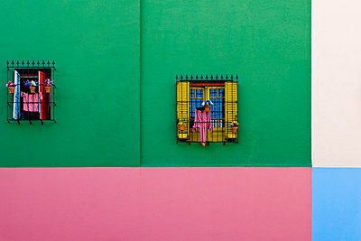 Windows in Colorful Building Exterior - p555m1453767 by Spaces Images