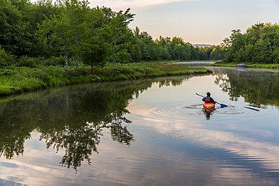 A kayaker on Northeast Creek on Mount Desert Island. Bar Harbor, Maine. - p343m1543742 by Jerry Monkman