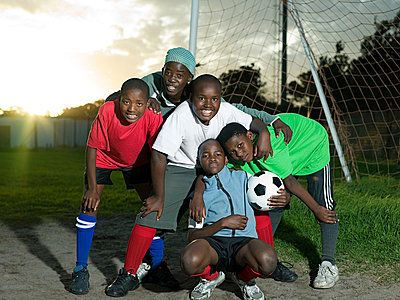 Group of teenage boys with football - p9246614f by Image Source