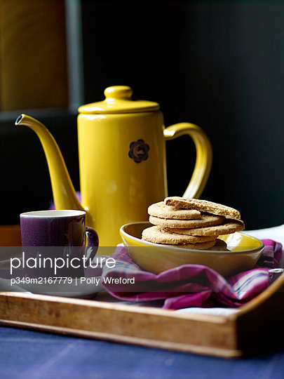 Digestive biscuits and coffee pot with mug and pink tartan - p349m2167779 by Polly Wreford