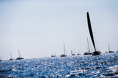 Sailing boats at sea - p312m1139737 by Peter Rutherhagen