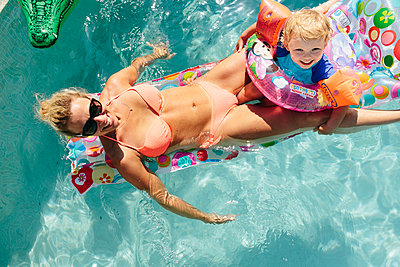 Mother and son in swimming-pool - p312m2050082 by Anna Rostrom