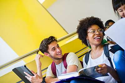 College students laughing while studying between classes - p623m1579581 by Frederic Cirou