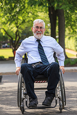 Caucasian businessman in wheelchair outdoors - p555m1306292 by Disability Images