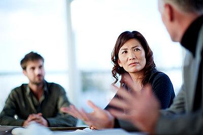 Business people talking in meeting - p1023m931060f by John Wildgoose