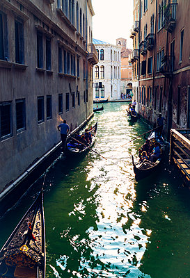 Gondola with passengers floats on small Venice canal - p1053m2005719 by Joern Rynio