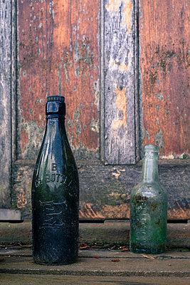 Two vintage glass bottles - p1228m1150142 by Benjamin Harte