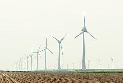 Row of wind turbines in field dyke landscape - p429m1469250 by Mischa Keijser